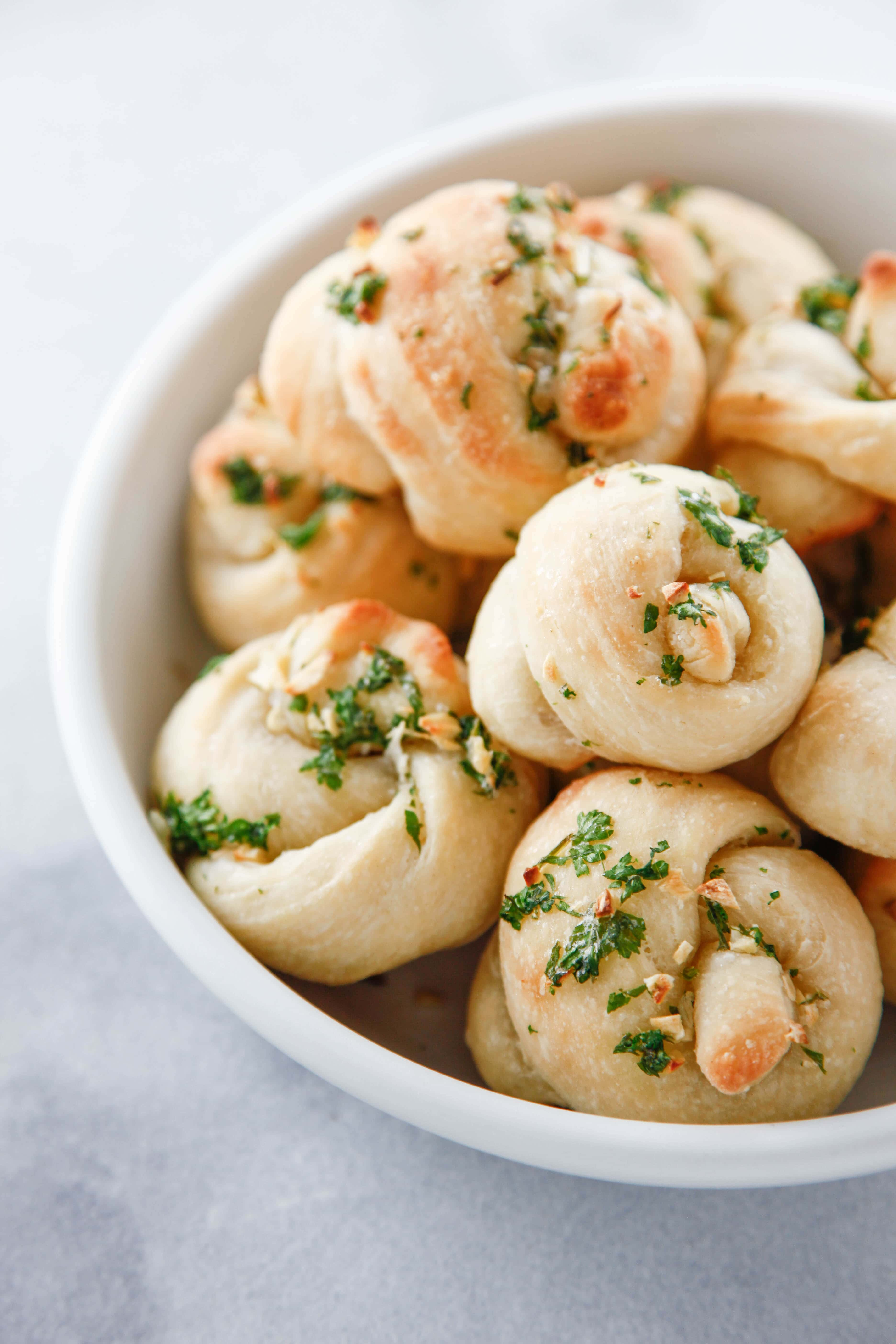 a close up of a bowl of Pizza Dough Garlic Knots.