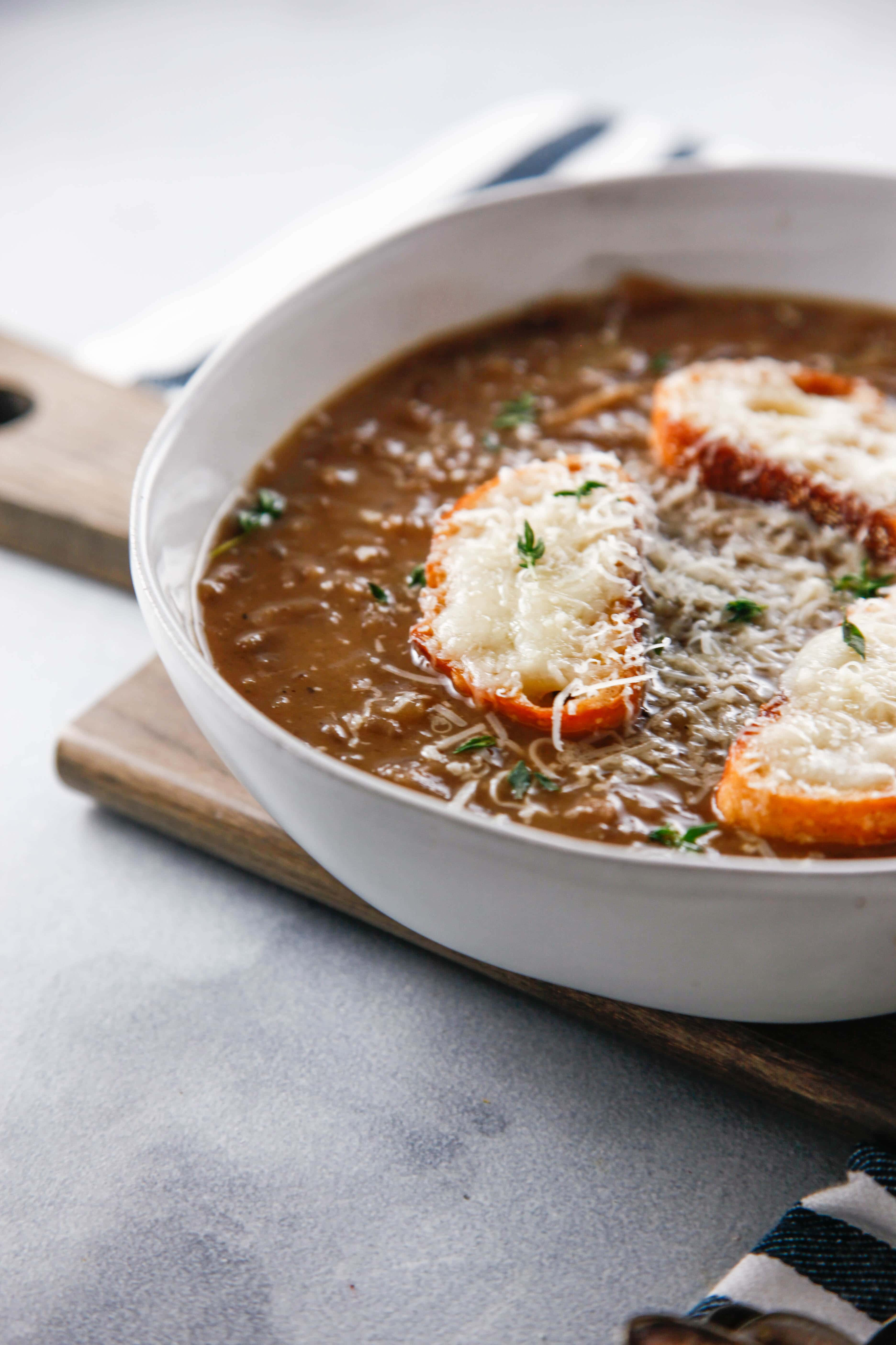 Classic Bistro French Onion Soup in a white bowl.